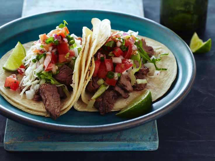 Tacos Carne Asada : Marinated flank steak plus pico de gallo, guacamole and queso fresco complete Tyler's five star tacos.
