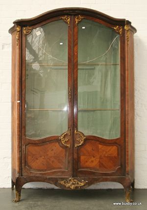 A 19th century kingwood armoir with glass...[Lot 216] - Busby Bridport Salerooms - 01308 420100