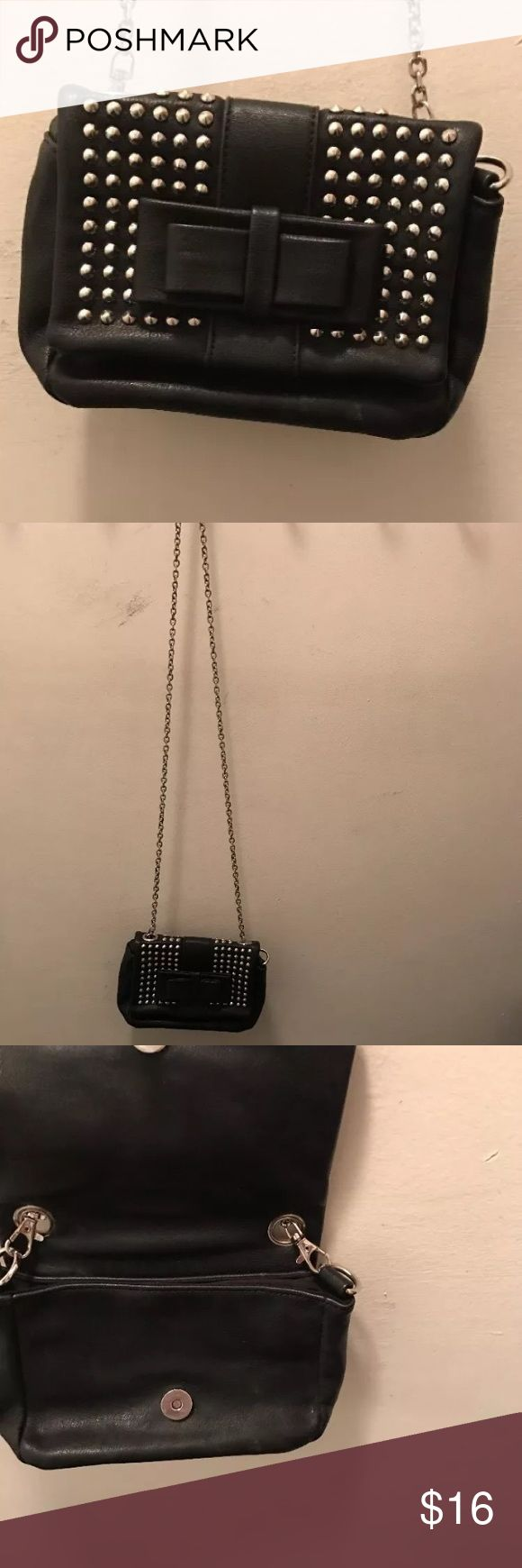 Cute studded bow handbag/ purse Fake leather studded w/ bow. Super long chain this is a small sized bag. Smoke free home!! Love Culture Bags Crossbody Bags