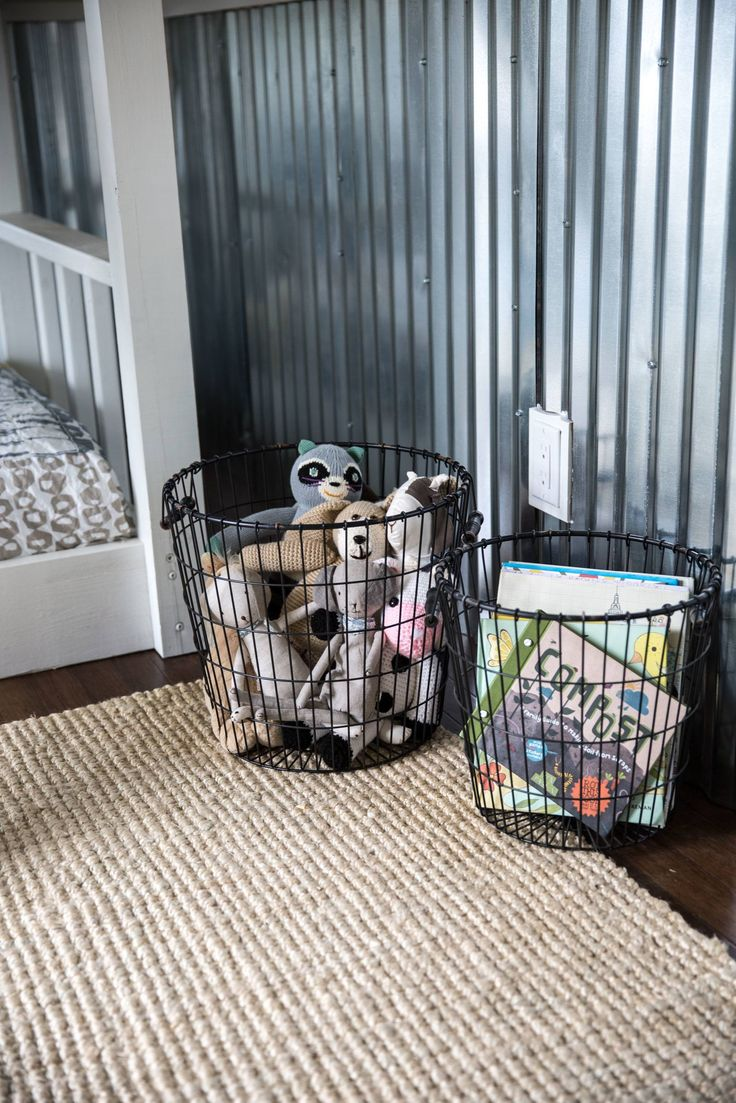 Wire baskets for toys and stuffed animals so they can see everything without dumping the entire bin