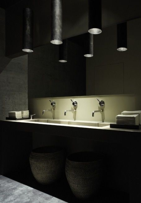 Restaurant bathroom by Iria Degen Interiors. Dark and refined..