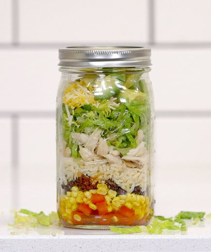 Mason Jar Chicken Burrito | This homemade burrito bowl is packed with protein, whole grains, and nutrient-dense veggies, and will sustain you from lunch until the end of the afternoon. Whisking up the dressing at the bottom of the jar ensures the lettuce at the top stays fresh and crisp, but that the veggies at the bottom are infused with spice and flavor. If you're planning on making the jar a few days ahead, hold off on adding the avocado (which browns easily once cut) until the morning…