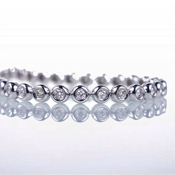 I'm not into tennis... But I love tennis bracelets!!  ;?  BEZEL Diamond Tennis Bracelet by samnsue on Etsy....$1,880