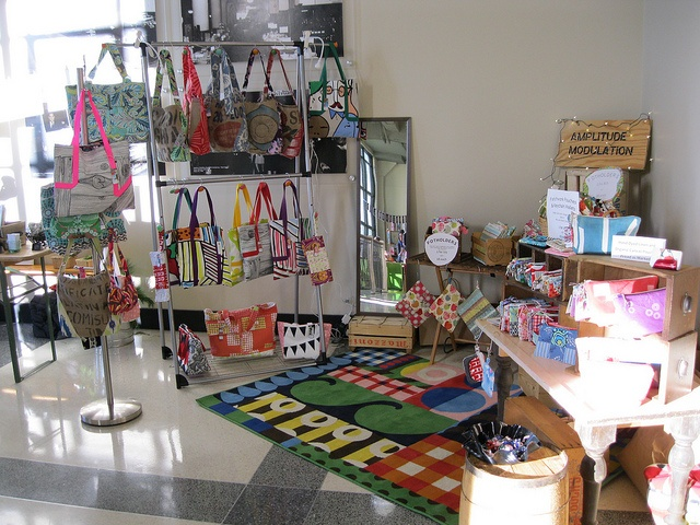 My Booth by EmilySue, via Flickr    Tote and small bag display ideas
