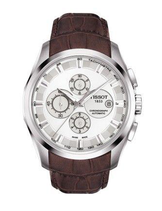 Montre TISSOT Homme Couturier, cadran blanc, chronographe automatique avec verre saphir anti-rayures, boîtier doré et bracelet en cuir marron.