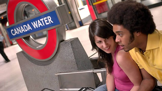 Couple sitting on a bench waiting at Canada Water Tube station. Photo: Eric Nathan