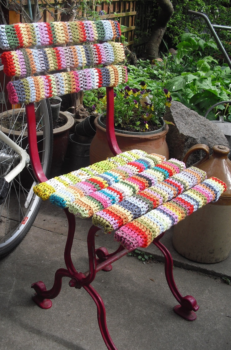 Garden chair yarn bombing, the strut at the back of seat is crocheted with up-cycled plastic bags.