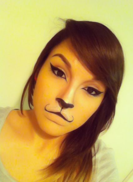 Cat makeup with a cool mouth look.