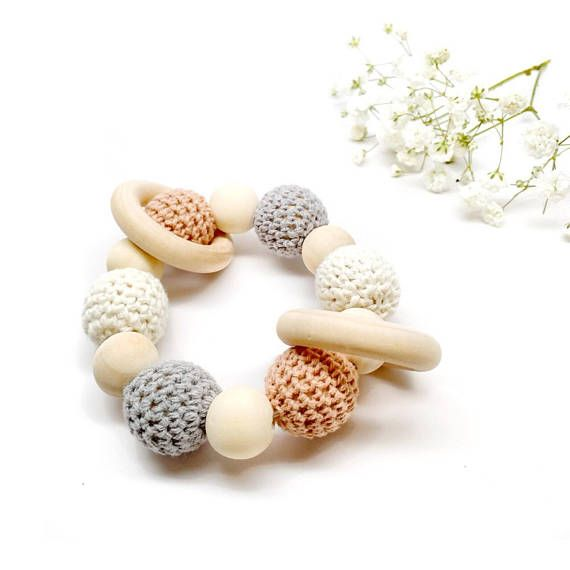 Our Organic Wood Bead Teething Toys are made from 100% organic material including natural beech wood beads, cotton yarn and waxed cotton cord. Completely natural and eco-friendly, each toy is double strung on strong cotton cord to ensure safety and durability. Get the matching Pacifier