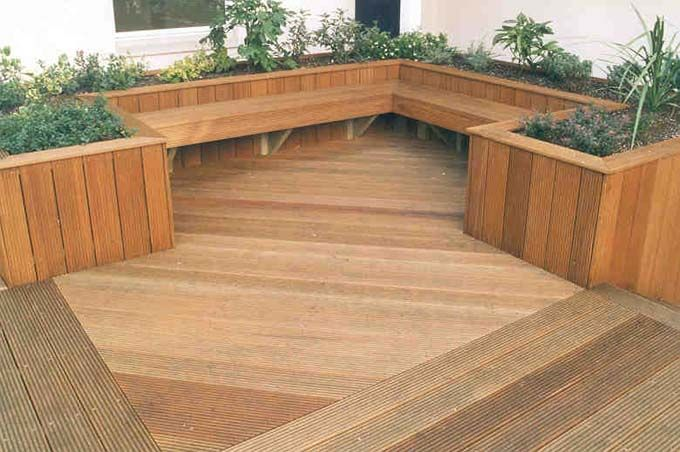 """""""Decking planters and built in seating - idea for fish pond"""" the fish pond would be even better, and maybe a different shade of wood."""