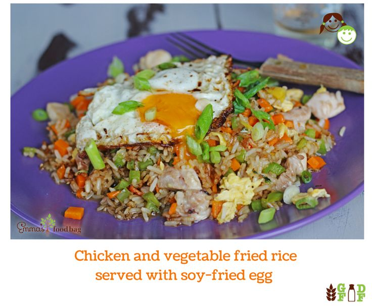 Chicken and vegetable fried rice served with soy-fried egg