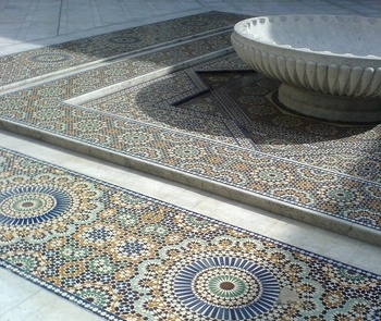 As a student in Paris some 30 years ago, I remember sipping tea at the restaurant in the Paris Mosque.  There was certainly an art to pouring the tea from so high above the glass.