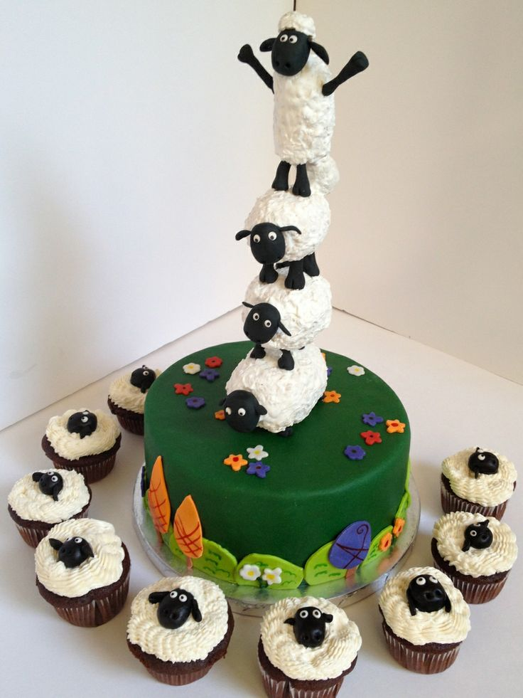 Wow    The sheep stack is made from cereal treats covered in royal icing with gumpaste heads and legs. The heads on the cupcakes are fondant (since kids will likely eat them and fondant tastes better).