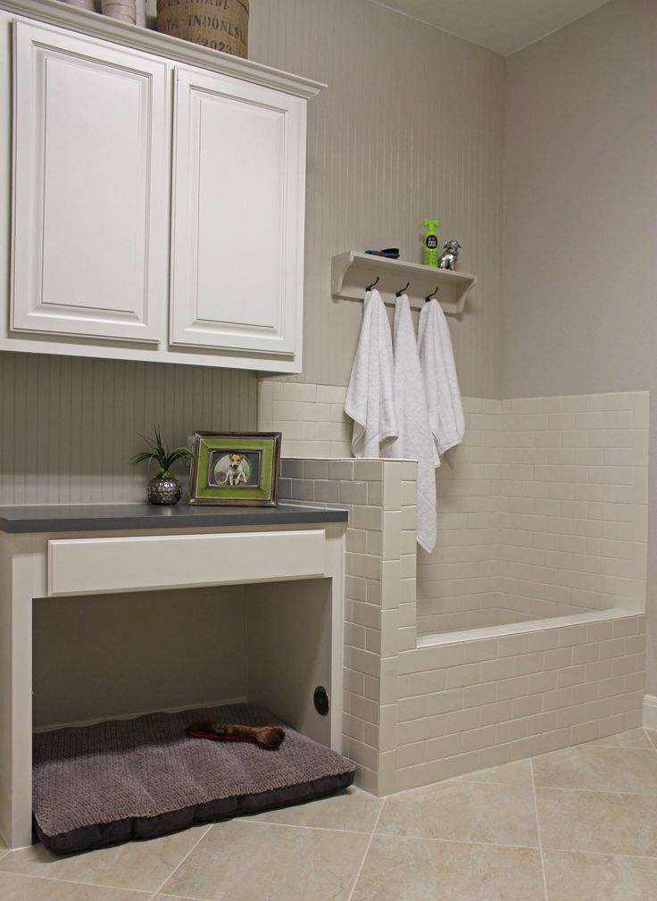 Laundry room with built in shower and under folding counter dog bed