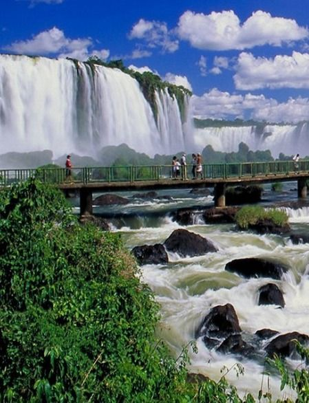 Iguazu Falls (Foz do Iguacu, Argentina / Brazil) straddles between two countries in South America. Truly stunning and an amazing natural wonder of the world.  Check out 52 global tourist attractions that actually live up to the hype