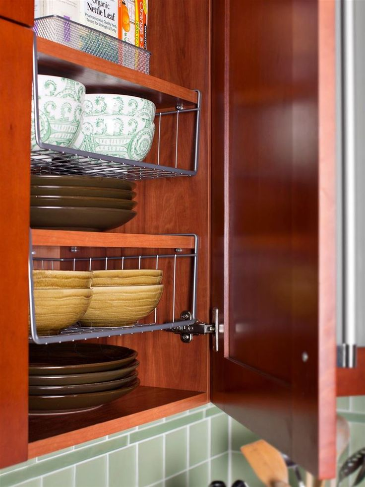 40+ Organization and Storage Hacks for Small Kitchens --> Increase your cabinet space with under-the-shelf racks