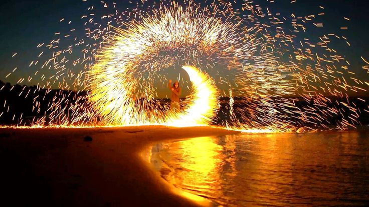 Steel Wool Fireworks on the Beach and a DIY tutorial on how to do it...  beautiful. amazing. pretty. fire. poi. twirl. swirl. light. sparks. fireworks. fourth of july. water. reflection. reflective. youtube video » http://www.youtube.com/watch?v=gnRcDtMniVE