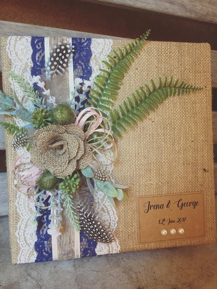 Rustic wedding guest books complete with hessian,  twine and handmade roses