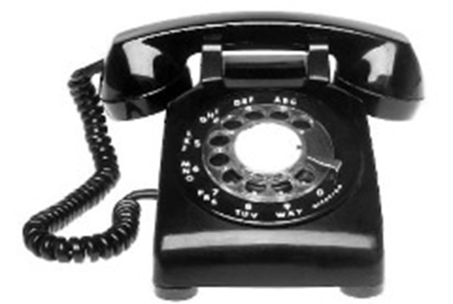 Black rotary dial telephone.  We had one of these when I was a child and a party line too, now that was a blast from the past.