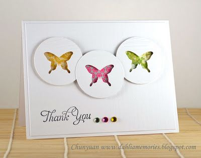 Stunning but simple card.  i love how she placed 3 rhinestones in the same colors as the 3 butterflies.