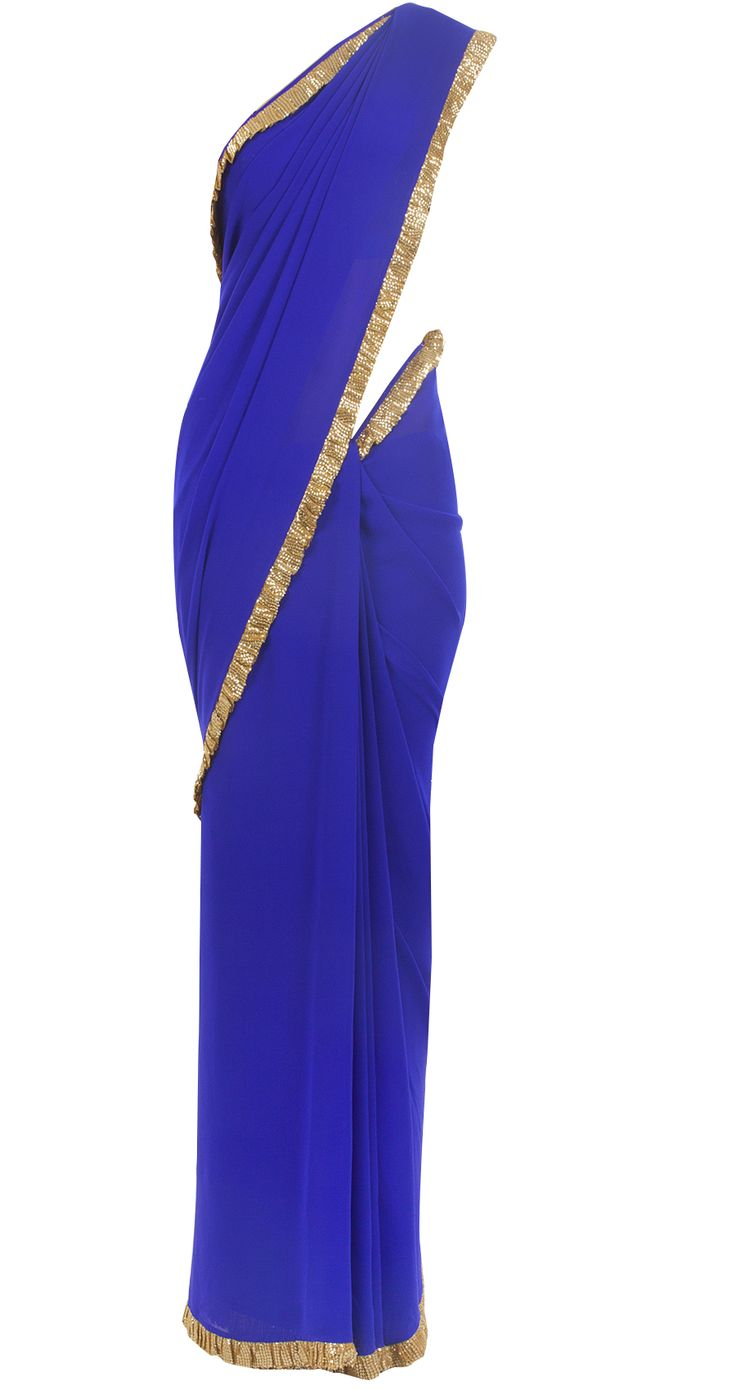 An exclusive Manish Malhotra style, cobalt blue georgette sari with champagne gold sequins frill. It comes with a sleveless black velvet hand embroidered blouse covered with black net. COMPOSITION: Georgette, velvet. Blouse lining: Butter crepe. CARE: Dry Clean Only. Outfit should be covered when not in use to safeguard the embroidery.