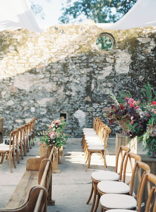 Colorful winery wedding ceremony: http://www.stylemepretty.com/2016/05/26/colorful-kunde-ruins-california-wedding/ | Photography: Emily Scott - http://emily-scott.co/