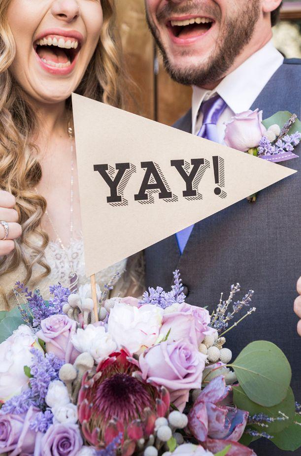 "Fun wedding photo ideas with ""yay"" sign | Peterson Design & Photography | See more on My Hotel Wedding: https://www.myhotelwedding.com/blog/2016/11/15/manhattan-beach-wedding-ayres-hotel"
