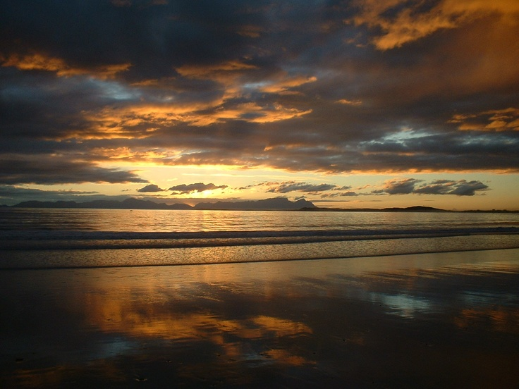 Strand beach sunset - Table Mountain on horison