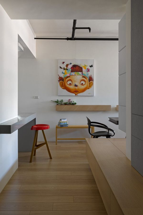 This bench wraps around the wall and has hidden storage. Renovation by Ganna Design Studio. http://design-milk.com/taiwanese-apartment-showcasing-toys-travel-souvenirs/