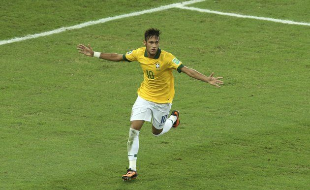 Brazil's Neymar celebrates scoring his side's 2nd goal during the soccer Confederations Cup final between Brazil and Spain at the Maracana stadium in Rio de Janeiro, Brazil