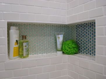 Nice touchy of penny round tiles in sea green & aqua blue colors in this retro Mid Century inspired Bathroom.