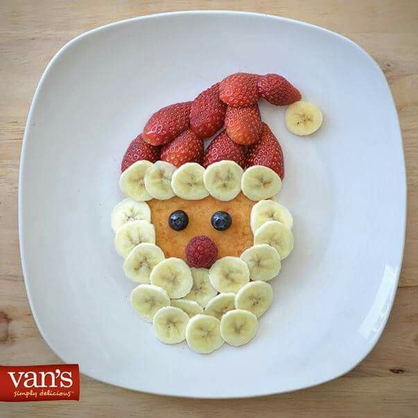 Great idea for this time of year.  One small pancake makes up the face, two blueberries for eyes, a raspberry for a nose, halved strawberries form Santa's hat, & sliced bananas make the beard & hat trim