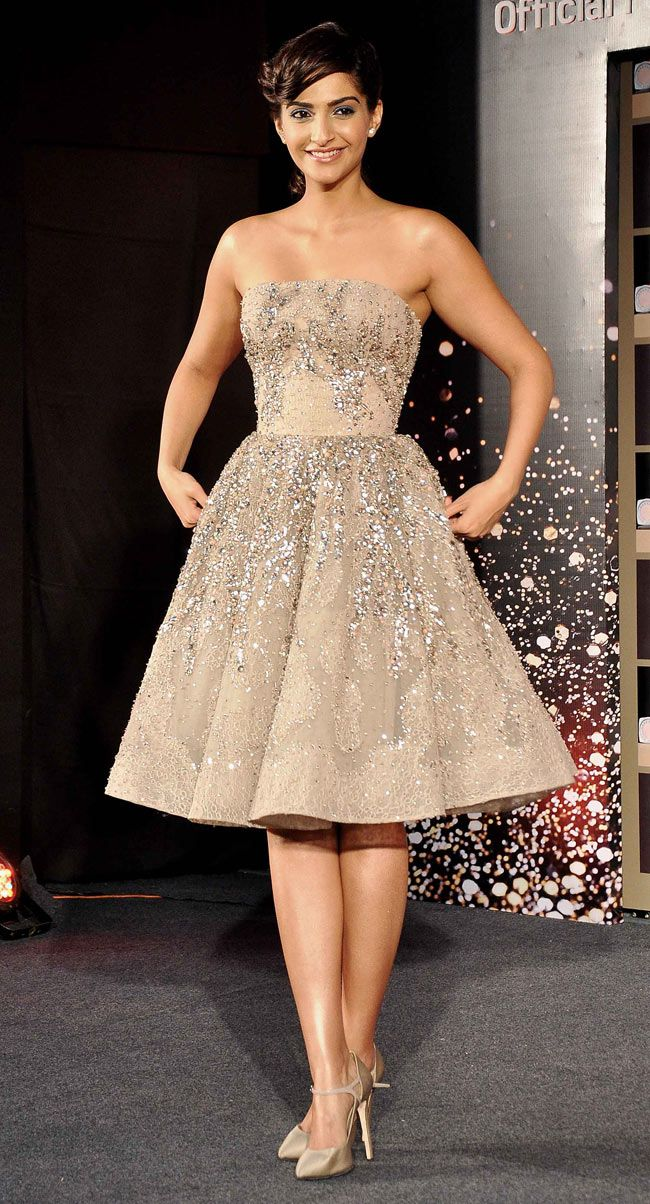 Sonam Kapoor at the launch of the L'Oreal Paris' Cannes l'or lumiere collection. This dress.