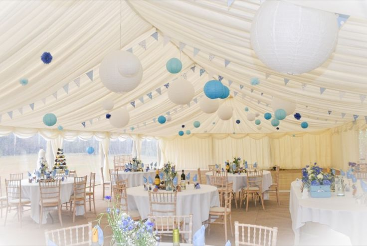 Blue and white paper lanterns look fabulous in this wedding marquee.