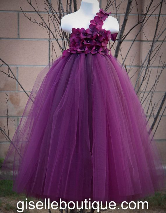 This gorgeous eggplant tutu dress is so beautiful, it makes you want to cry tears of joy! Your girl will look so beautiful and feels like a fairy princess wearing this tutu dress. This dress will be the perfect dress for birthday, flower girl, photo props, pageants, and many more......  Dress looks even more beautiful in person!  Dress is created with the finest of materials. Crochet bodice comes covered with jeweled hydrangea flowers and is tied with lovely satin ribbon on one shouder…