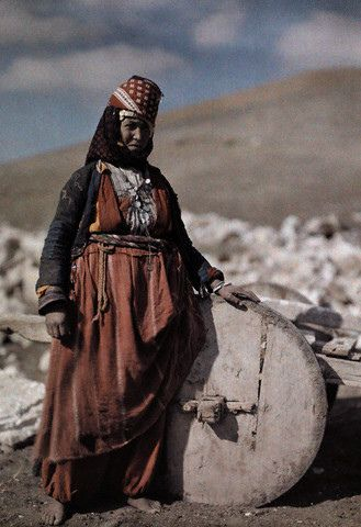 """Turkmen Woman, Anatolia, Turkey. 1932.This is during the Ottoman Empire when these people were known as """"kizilbas """"[the red heads] because they wore red wool caps. Red was a sacred colour and indicates this woman is married. Green and white were also scared colours. They followed the Shi'i Islam belief and were unveiled and enjoyed liberties as nomadic farmers."""