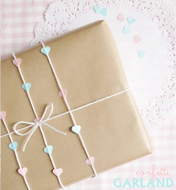 Simple but oh so pretty gift wrapping, made using Kraft paper and pastel heart string of bakers twine and tiny paper hearts glued together. Perfect for a baby shower gift. #giftwrapping #babyshower #diy | Run Wild Horses