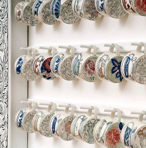 teacups..on teacups. sweet. Molly Hatch Pottery.