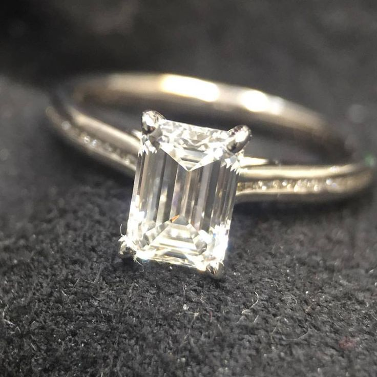 A gorgeous pic snapped by our client moments after they proposed, highlighted by an ideal cut Emerald cut diamond! #emeraldcutdiamond #yycdesign #yycjewelry #engagementring