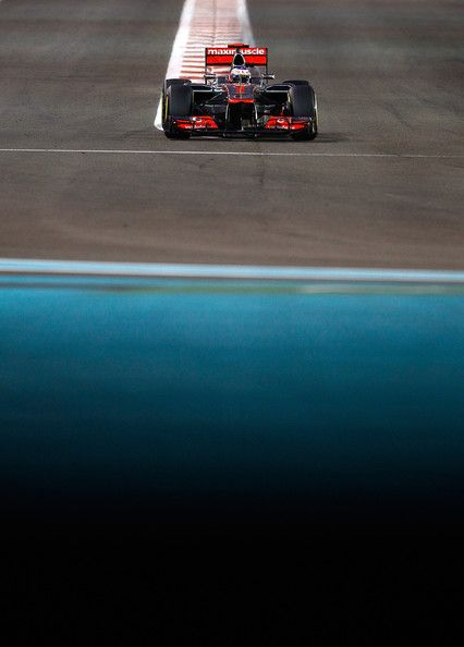 Jenson Button of Great Britain and McLaren in action during the Abu Dhabi Formula One Grand Prix