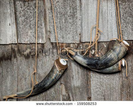 19th Century Gun-Powder Horns hanging on wall  - stock photo