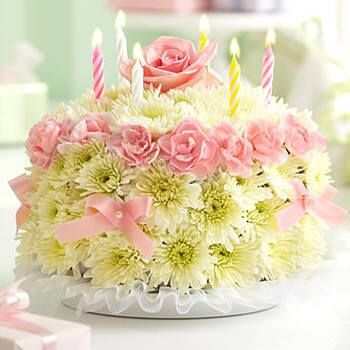 """Amazing """"FLORAL CAKE"""" not really cake but made entirely of fresh flowers.  Could be done as a real cake also."""