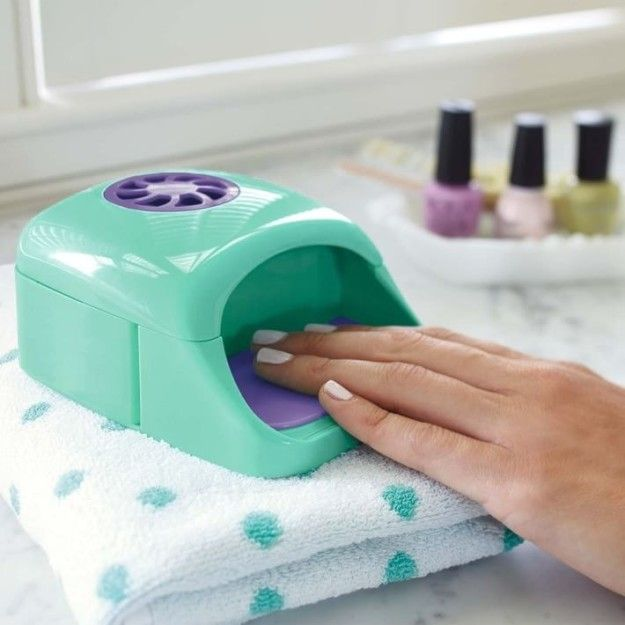 A nail dryer that automatically turns on when you place your fingertips on the…