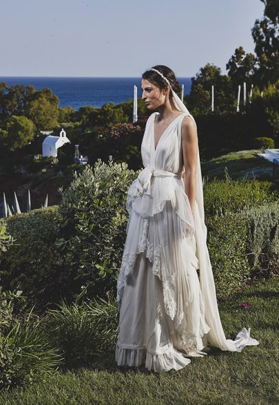 Grecian wedding gown with lace details by Melina Pispa