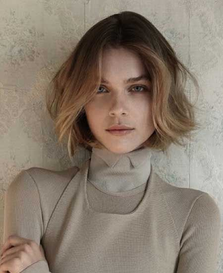Wavy, short hair with a center part. I like that it all seems to want to go one direction, as mine sometimes does.