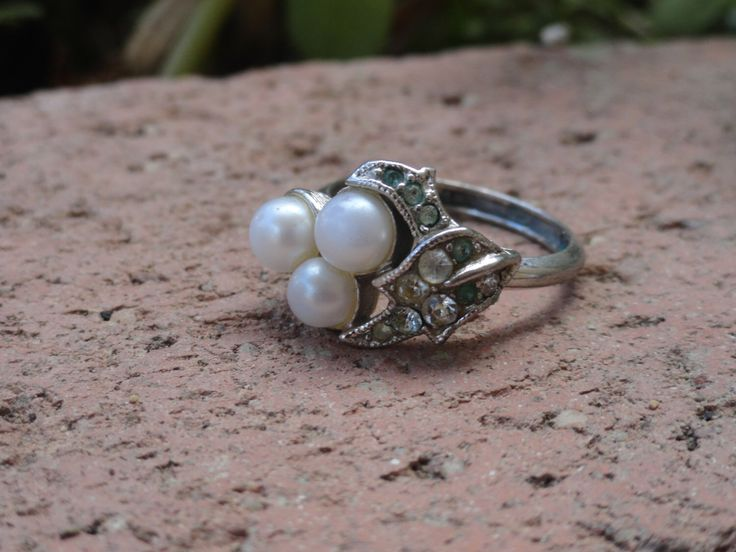 A personal favorite from my Etsy shop https://www.etsy.com/listing/202024865/1960s-avon-crystal-and-faux-pearl-ring