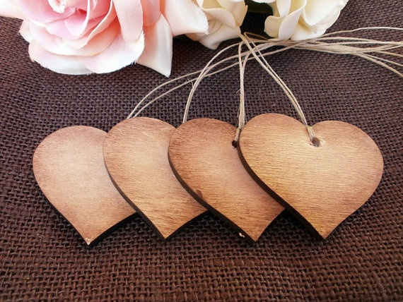 """Great idea for escort cards, especially for those brides that are going for the """"rustic"""" theme - Rustic Wood Heart Tags by MelindaWeddingDesign on Etsy"""