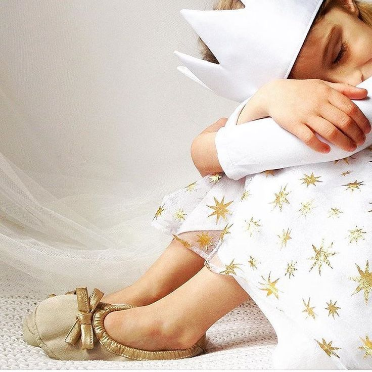 Varvara from Krasnodar loves our textile girl shoes with gold bow