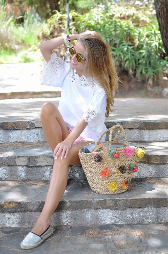 Espadrilles, pompones bag, pink shorts and lace blouse