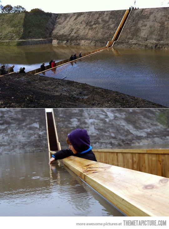 "The Moses Bridge - This incredible ""sunken"" bridge located in the Netherlands is giving visitors a unique way to access a beautiful 17th Century Dutch fort"